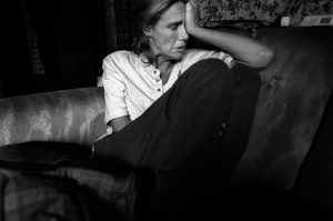 Julie cries after her father dies on Easter Sunday. From the series Family Love by Darcy Padilla. Valdez, Alaska 2007.