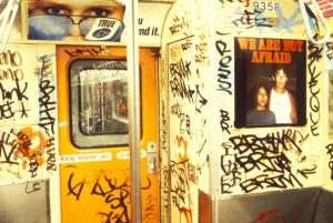 Photo of We Are Not Afraid art on the subway train by Les Levine